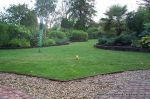 Flower beds & lawn edged with treated timber edging and sawn sleepers