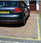 Driveway installed with Marshalls Driveline 50 in brindle with buff & charcoal contrast bands and mitred corners