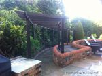 Curved timber arbour built on both a incline and radius