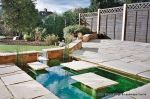 Sandstone patio with sunken water feature and stepping stones