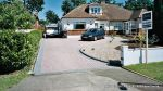 Sweeping curved driveway installed with Marshalls Driveline 50 in brindle and Charcoal Kerbs