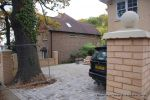 AFTER: Driveway was constructed with tumbled paver's in graphite grey, brick wall and pillars built using matching brick to property