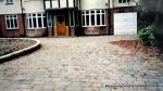 New driveway installed using Marshall's Tegula paving with contrasting charcoal border