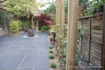 Town house garden paved with black limestone