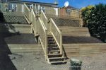 Timber decking, Balustrade and cladding, Timber steps were constructed for a drop of some 20 feet