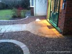 AFTER: Sweeping sandstone path installed leading to front door, driveway perimeter edged with sandstone setts all hand pointed, Natural sandstone wall constructed with crease tile and 6mm Scottish beach gravel installed to drive.