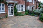 Driveway constructed using Crazy paving with red brick edging
