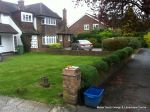 BEFORE: Driveway with old cracked concrete and mainly lawn with overgrown hedge