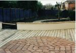 Terracotta tile octagon set in decking