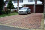 Shared driveway installed with Marshall's Driveline 50 in red and buff border