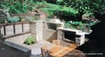 Sunken patio/dining area with natural Cotswald random stone retaining Walls with Integral BBQ and timber beams
