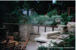 Sunken patio/dining area with natural Cotswold random stone retaining Walls with Integral BBQ and timber beams