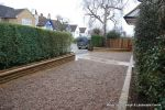 Sweeping sandstone path installed leading to front door, driveway perimeter edged with sandstone setts all hand pointed, Natural sandstone wall constructed with crease tile and 6mm Scottish beach gravel installed to