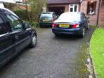 BEFORE: Tired and patchy old tarmac driveway