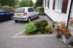 AFTER: New driveway installed using granite paving with contrasting colour band