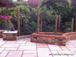 Garden needed a new landscape to match the character of the property a Sweeping ramp was installed with timber curved arbour, tumbled sandstone paving & circle installed and in cased with old stock brickwork capped with double bullnose steps built  with m