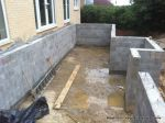 Deck and underfloor storage room built using Concrete block retaining wall with added rebar and concrete for strength