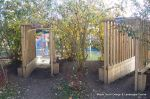 Timber tunnels built through the undergrowth for school nursery