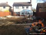 DURING: Lawn is removed topsoil installed and levelled and patio starts to take shape