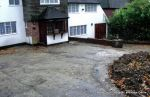 BEFORE: Old concrete driveway broken and crumbling