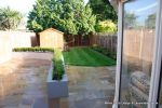 Lawn edged with raised decorative kerbs