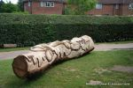 After: This mighty oak trunk is given a new lease of life with a beautifully carving of a woodland wildlife scene including butterflies, beetles oak leafs and acorns for the children of the nursery to enjoy for many generations to come.