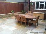 Patio installed with 4 size sawn sandstone paving edged with firestone rocks and alpine planting, steps built with sawn sandstone uprights and sawn sandstone bullnose treads