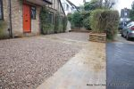 Sweeping sandstone path installed leading to front door, driveway perimeter edged with sandstone setts all hand pointed, Natural sandstone wall constructed with crease tile and 6mm Scottish beach gravel installed to drive